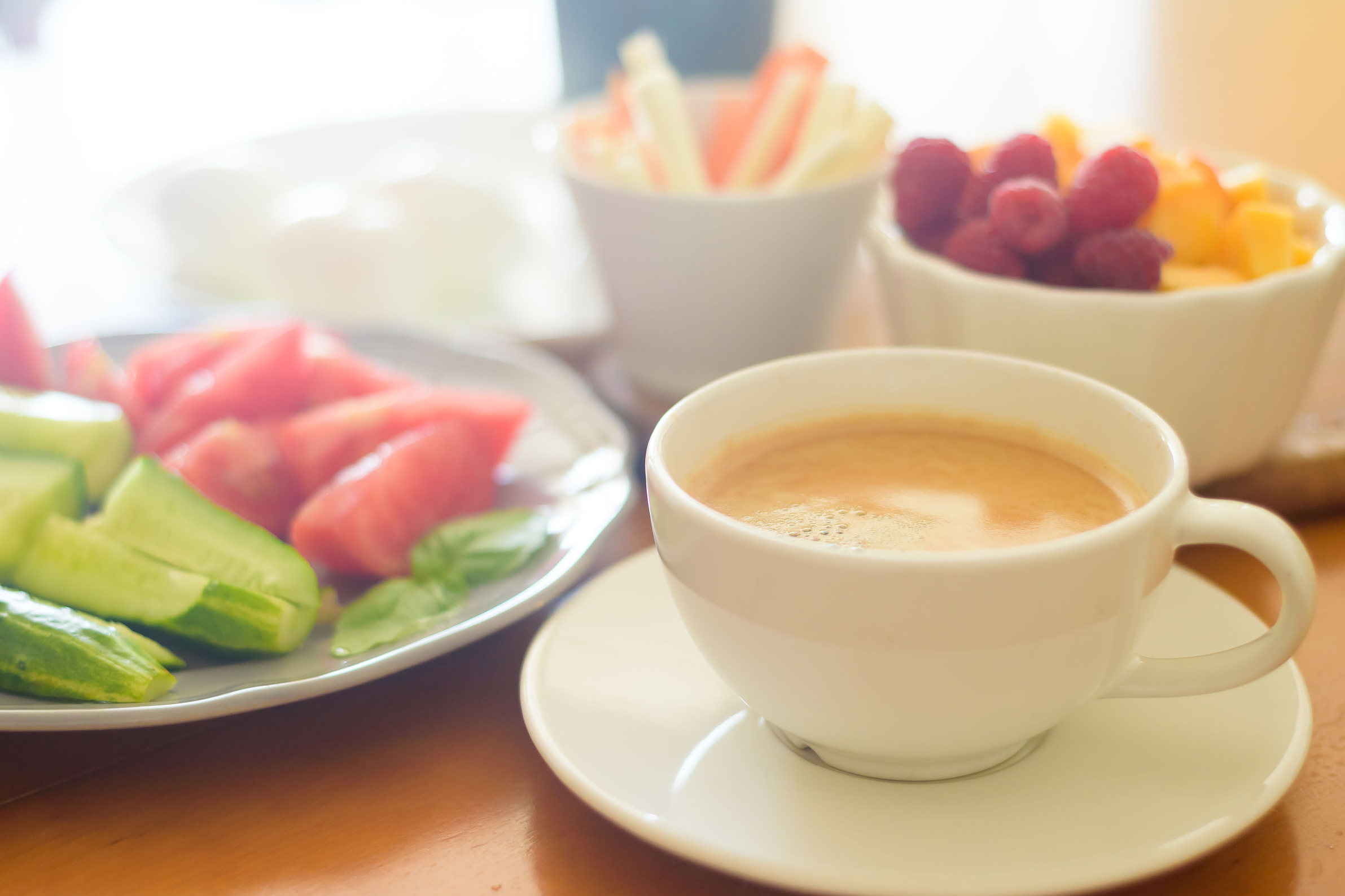Breakfast with coffee, vegetables and fruits
